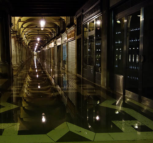 This corridor, which circles St Mark's, is 6 inches higher than the square itself, and it also flooded over.