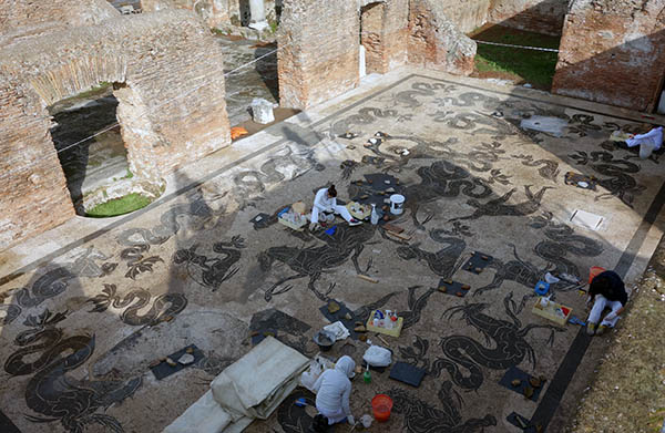 Archaeologists preserving the mosaics